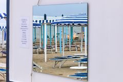 Beach in the reflection of the mirror, Italy, Riccione. Beach in the reflection of the mirror Stock Image