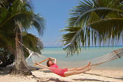 Beach relax. Girl relaxing in a hammock on the tropical beach Stock Photo