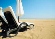 Beach relax. Relax chairs on a beach with golden sands Royalty Free Stock Photography