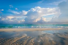 Beach. Relax on beach. Beach with sand and blue sky with awesome fluffy clouds royalty free stock photography