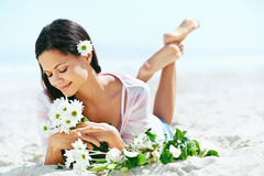 Beach relaxing woman Stock Photos