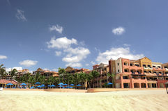 Beach Resort. A Mexican resort with sandy beach in the foreground and big blue sky Royalty Free Stock Images