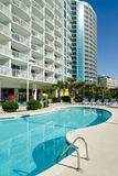 Beach resort buildings. With swimming pools on foreground Royalty Free Stock Photo