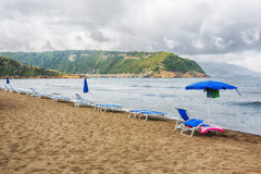 Beach resort with chairs and umbrellas. Royalty Free Stock Images