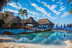 Beach Resort in Mexico. Beautiful beach resort with pool and palapa bar on the beach in Mexico Royalty Free Stock Image