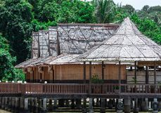 Beach resort with nipa hut cottages and forest as background stock images