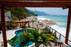 Beach resort pool with view. Playa Fiesta Puerto Vallarta coastal beach resort swimming pool with a view of the Pacific ocean Stock Photo
