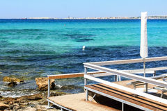 Beach resort on the sea. The platform of a beach resort on the coastline of Salento, near Gallipoli Royalty Free Stock Photos