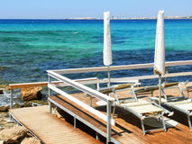 Beach resort on the sea. The platform of a beach resort on the coastline of Salento, near Gallipoli Stock Photo