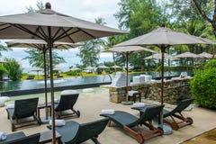 Beach resort swimming pool. A stylish beach resort swimming pool in Phuket, Thailand Royalty Free Stock Photos