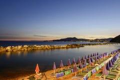 Beach resort on Tigullio gulf at dusk, Chiavari, Italy Stock Images