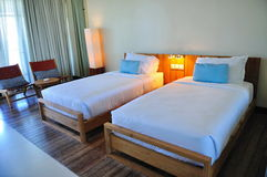 Beach resort twin bed room. Twin luxury bed room in a tropical beach resort Stock Image