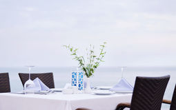 Beach restaurant. White table of a beach restaurant in the evening stock image