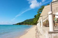 Beach restaurant. At the white beaches of Beau Vallon Bay, Mahe island, Seychelles Stock Photo