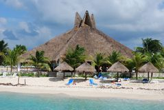 Beach Restaurant. The restaurant with a straw roof on one of many Cozumel island beaches (Mexico royalty free stock photos