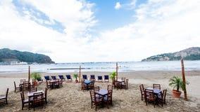 Beach Restaurant Chairs Table Water Resort Dinner Lunch Breakfast Ocean Beach Water Bay San Juan Del Sur Nicaragua. Nicaragua Paradise Beach Vacation Tourist Royalty Free Stock Image