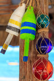 Beach Restaurant Decorations, Buoys and Glass Globes. Hanging buoys and colorful glass globes in beach side restaurant royalty free stock images