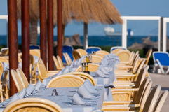 Beach restaurant. Dining tables on outdoor summer beach restaurant royalty free stock images