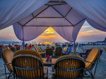A Beach Restaurant. Goa, India - December, 21 2017 : Beautiful beach restaurant at the cozy sand beach located at North Goa is the best place to relax, drink royalty free stock images