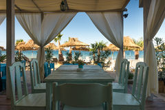 Beach restaurant table Royalty Free Stock Photography