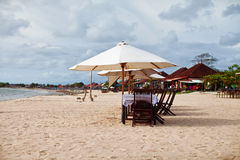 Beach restaurant. Tables, chairs and umbrellas on the beach royalty free stock photo