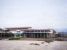 Beach Restaurants. Next to fishing boats on sand and mud Stock Images