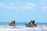 Beach restoration with bulldozers Stock Images