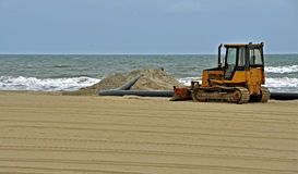 Beach Restoration at Virginia Beach. A bulldozer sits on the sand as part of the beach restoration project at Virginia Beach Royalty Free Stock Image