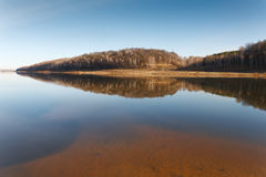 Beach of the river in cold autumn day Royalty Free Stock Images