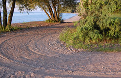 Beach Road. A background with a view of a curving road leading to a beach royalty free stock photo
