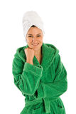 In Beach Robe and Headtowel. Nice woman in green bath robe and towel wrapped around her head Royalty Free Stock Photo