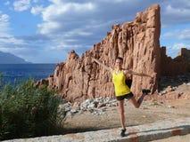 Beach of Rocce Rosse - Arbatax - Sardinia. Happiness on red rocks beach - Sardinia Royalty Free Stock Photos