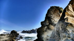 Beach Rock Face. A side face view of the rock see the nose, chin and forehead. Watching the rough sea Stock Photo