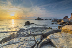 Beach rock with sunrise Royalty Free Stock Photo