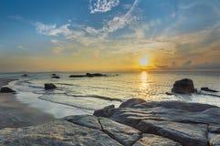 Beach rock with sunrise Stock Photo