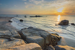 Beach rock with sunrise Stock Photography