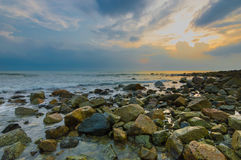 Beach rock with sunrise Stock Photos