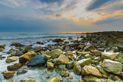 Beach rock with sunrise Royalty Free Stock Image