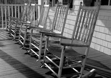 BEACH ROCKERS (black and white). Rockers on porch of beach house Stock Images