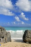 Beach Rocks. Waves coming in to the beach in Tulum, Mexico Stock Images