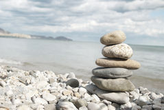 Beach Rocks. A tall pile of rocks stacked on the beach Stock Photo