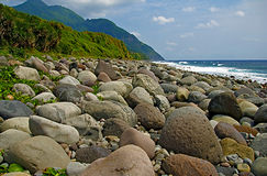 Beach Rocks. Rocks along the beach of Valugan, Batanes, Philippines. It is said that the rocks came from the nearby volcano royalty free stock images