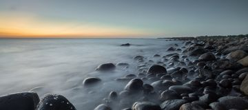 Beach of Rocks in the Afternoon stock photography