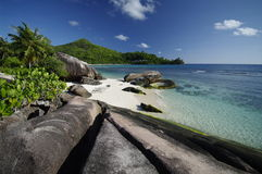 Beach with rocks at Baie Lazare, Seychelles Stock Images