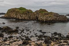 Beach and rocks in Ballintoy Harbour. Moyle, Northern Ireland, UK stock images