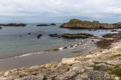Beach and rocks in Ballintoy Harbour. Moyle, Northern Ireland, UK stock photos