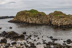 Beach and rocks in Ballintoy Harbour. Moyle, Northern Ireland, UK royalty free stock photography