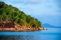 Beach rocks sea palms island Stock Photos
