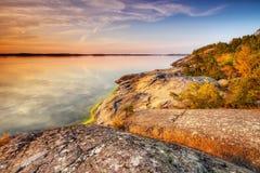 Beach rocks. In silent warm summer evening with still water in Porkkalanniemi , Finland Stock Images