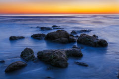 Beach Rocks Sunrise Stock Photo
